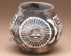This vase is a high quality piece of authentic Native American, Navajo pottery…