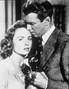 Still of James Stewart and Donna Reed in It's a Wonderful Life