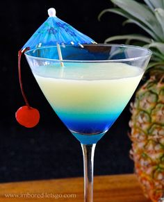 Pina Colada-tini (2 oz. rum 1 oz. coconut rum 2 oz. pineapple juice 1 oz. cream of coconut 1/2 oz. blue curaçao)