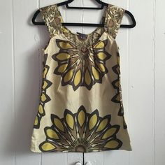Vince. Sleeveless shell blouse top XS Beautiful medallion/flower-like print blouse by Vince. in a mixture of earth-tone colors like olive green, mustard, brown. Excellent pre-loved condition! No stains or wear noted but as I was ironing, left a very small water mark from the steam (as noted in the last pic). Ruched sleeves and pin-tuck neckline, 100% silk. Also, the tag is literally hanging on by a thread. Clearly doesn't take away from it but just wanted to note! Vince Tops Blouses