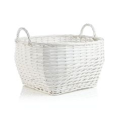 Generous willow basket shows off its simple weave and large, rounded shape with its clean, matte white finish that speaks to summer homes and cozy cottages.