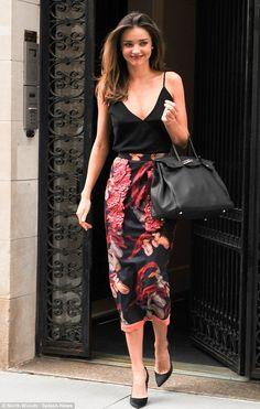 July 17, 2014: Natural beauty: Miranda Kerr showcases radiant good looks and slender figure as she leaves...