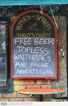 Funny bar sign...FREE BEER..TOPLESS WAITRESSES...AND FALSE ADVERTISING