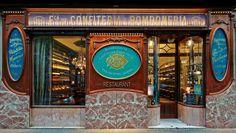 La pastelería Reñé es uno de los históricos de la parte derecha del Eixample de Barcelona, que desde 1900 ha endulzado la vida de sus vecinos como fábrica de dulces y posterior pastelería. Ahora abre sus puertas como bar restaurante conservando su esencia como icono modernista.