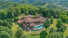 Kenny Chesney's 56-Acre Nashville Estate Lists for $14 Million – Robb Report Flora Bama, Tiled Staircase, Lookout Tower, Waterfall Features, Entertainer Of The Year, Kenny Chesney, Tuscan Style, Celebrity Houses, Romanesque