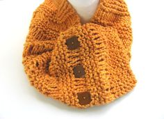 This #cotton #pumpkin #cowl will be a great transition piece for the different seasons. Knit with a 100% cotton yarn in a soft orange pumpkin shade it has additional texture through the stitches. At one end are 3 vintage square, brown buttons. The loopy parts of the stitch allow the buttons to go in anyplace....wear it tight, loose or in between!Perfect piece for any female-young or not!FREE US shipping and reduced elsewhere. #zibbet