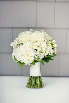 An all-white wedding bouquet is a staple of any gorgeous wedding