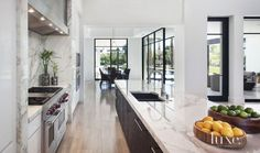 Modern White Kitchen With Limestone Flooring