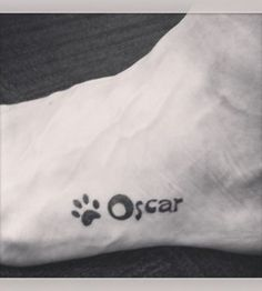 Pawprint Oscar dog tattoo