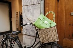 Not the bag (although that apple green is nice), the cool basket on that very serviceable bike. The website has way too many shoe obsessions. Just an opinion. @Beth Wheeler honestly I am just looking at the beautiful green purse LOL had to share