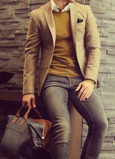 Comprar ropa de este look:  https://es.lookastic.com/moda-hombre/looks/blazer-jersey-con-cuello-barco-camisa-de-manga-larga-vaqueros-bolsa-de-viaje-panuelo-de-bolsillo/5310  — Bolsa de Viaje de Cuero Negra  — Vaqueros Gris Oscuro  — Blazer de Tartán Marrón  — Jersey con Cuello Barco Mostaza  — Pañuelo de Bolsillo a Lunares Negro y Blanco  — Camisa de Manga Larga Blanca