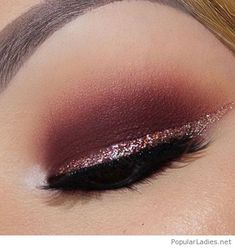 Burgundy eye makeup with some glitter