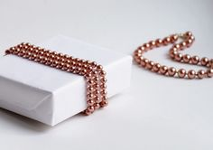 Use a string of pearls to tie your present.