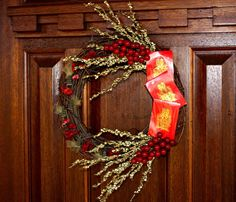 Wreath Accented With A Red Envelope As Symbol Of Authentic Chinese New Year Decorations