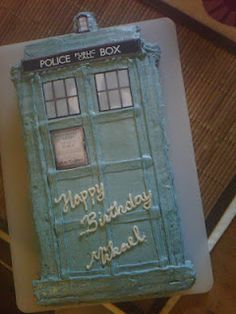 TARDIS cake!  (Dr. Who) My Sister-in-law made this amazing cake for my brother's birthday yesterday!!  http://www.nouvellegamine.com/2012/03/tardis-cake-for-my-husband.html