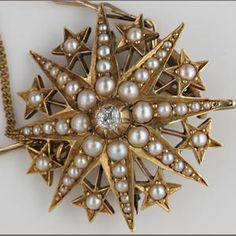 An Edwardian seed pearl and diamond brooch/pendant