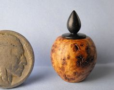 Jeff Spera - Hollow turned from a piece of black ash burl, this lidded vessel features a lid of African wonderstone; sold on ebay for $18