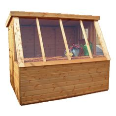 Possible shed for bottom of garden - pots around front - insect homes etc