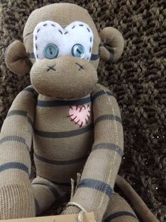 Chandler is a hand stitched sock monkey and is by ChikiMonkeys