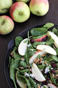 I'm pretty much in love with this salad: spinach (+ mixed greens), blue cheese, apples, walnuts (or almonds), chicken for a little protein and a good balsamic. I can crave this!
