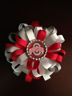 """Hey+Buckeye+fans!++Show+your+team+spirit+with+this+large,+3-1/2""""+loopy+bow.+++This+winning+combination+of+red,+gray,+and+white+is+topped+off+with+an+Ohio+State+logo+bottlecap+embellishment.++All+edges+have+been+heat+sealed,+with+no+use+of+chemicals,+for+that+perfectly+polished+look.+This+bow+is+a..."""