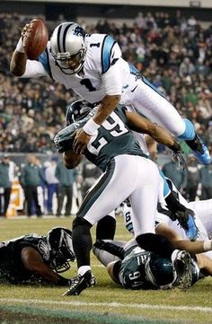 Panthers QB, Cam Newton, dives over Eagles defenders for a touchdown! #Cam #NFL