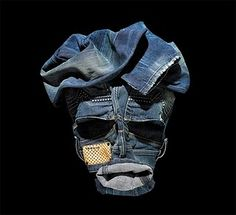 This image is of a simple shirt that has been folded beautifully as an 'expressive fashion face'.    Bela Borsodi, an Austrian photographer created a series expressive fashion faces by using the clothings from an online store, Yalook.    He picks up shirts, jeans, jackets or just about any clothing and transforms them into an art with personality.
