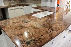 Cabernet Bordeaux Granite Kitchen Island - color is a little off - it's more red/coral