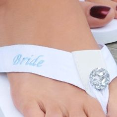 @Overstock - These dazzling flip-flops are perfect for comfortable running around on your wedding day or honeymoon. A soft foam sole is topped with grosgrain patterned fabric embellished with a blue 'Bride' and a giant rhinestone at the toe.  http://www.overstock.com/Clothing-Shoes/Cathys-Concepts-Bride-White-Foam-Flip-flops/6590404/product.html?CID=214117 $22.49
