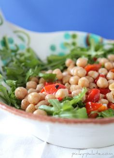 This fresh Lemon Drizzled Chickepea and Arugula Salad makes for a delicious weeknight meal.