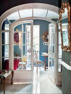 How charming is this Spanish flat in Barcelona's Gràcia district?! I just love themix of period pieces ranging from the 19th century to modern day. And the contrast between the white floors and the dark painted walls are inspiring - an idea I'm definitely saving for later.