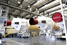 The three first-stage booster cores for United Launch Alliance's Delta 4 Heavy rocket are seen here inside the Horizontal Integration Facility at Cape Canaveral Air Force Station on May 7, 2014. The Delta 4 Heavy will launch NASA's Orion capsule on its first test flight in December 2014.<br />
