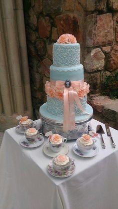 Duck egg blue and peach wedding cake