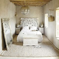 This carved headboard adds an instant old world feel and sense of travel and exploration to the space.