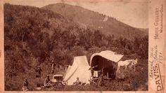 Here you can see the Davis (Braun) family encamped in the  Nasach Mountains in Colorado...you can see little Ed carrying a  water pale in the lower left foreground.