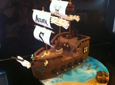 Cake Artist said:  Birthday Cake Photos - Pirate ship cake for my sons 5th birthday.  Sails are made out of gumpaste and everything else fondant.  Has a disaster the day before him party when the entire bow of the ship fell off (cake was just not strong enough to support decorations despite dowel supports).  I used approximate 23 rice krispy treat bars to reconstruct the bow of the ship and attach it to the cake.  Thank goodness it worked!