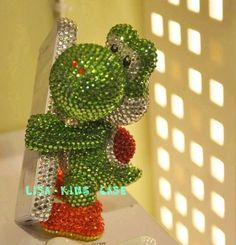 Crazy, awesome, over the top Yoshi iPhone case ... I kind of want it