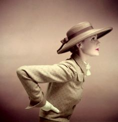1950 Model is wearing a cocoa Milan straw sailor hat, banded with grosgrain and jacket of complimentary colors.