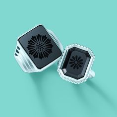 Tiffany & Co. Ziegfeld Collection daisy signet ring and daisy ring, both in sterling silver with black onyx. #TiffanyPinterest