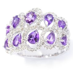 This ring features a wide band with swirl scrollwork lined with sparkling white topaz. Made of sterling silver, this ring offers an opposite-facing purple amethysts are woven between the swirls for a