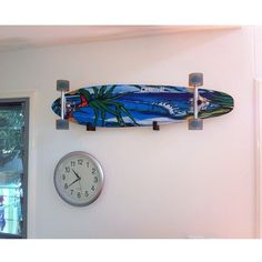 """When you are not riding our """"Burleigh Point"""" longboard it makes a great show piece for your wall! thanks for the pic @maggiemccagh #obfive #longboard #burleigh #surf"""