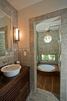 love the sunken bath tubs I think the are gorgeous, also like the design of this bathroom
