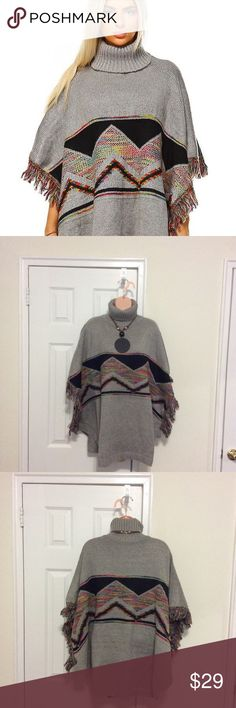 "Aztec Multi Tone Tassel Accent Turtleneck Poncho Super Great Aztec Design Poncho. Great for the incoming Spring, Cool Summer night and Fall weather. Looks good with Jeans, Slacks, leggings and Maxi skirts or dresses. Measures 50""x84"" Sweaters Shrugs & Ponchos"