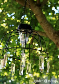 Easy DIY Solar Light Chandelier  - Make this project in no time with a few common materials and then let your imagination run wild in decorating it.