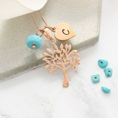 Personalised tree of life December birthstone necklace in silver, rose gold or gold. Full of symbolism the tree charm is a meaningful gift for a special occasion. Add additional charms to create a family tree Birthstone Charms, Birthstone Necklace, Turquoise Jewellery, December Birthday, Tree Of Life Necklace, Letter Charms, Heart Locket, Pearl Stud Earrings, Initial Charm