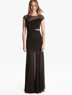 Alluring asymetrical contrast panels at the hip and bust transform this capped sleeve gown into a captivating choice for any evening.     ...