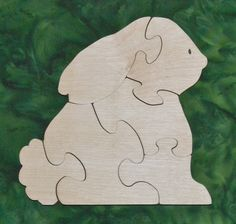 """This Rabbit Puzzle is fun to do and assists in the development of small motor, hand-eye coordination, visualization and problem solving skills all of which are important in the process of reading. Our puzzles are made from toy quality 1/2"""" Baltic birch plywood and are rubbed with AMF Naturals, an oil wax finish that is completely safe. Dimensions: 7.25"""" high, 7.25"""" wide"""