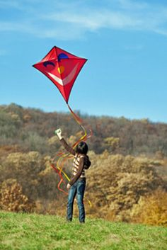 """7. Flying a kite     """"Don't be afraid of opposition. Remember, a kite rises against, not with the wind.""""   - Hamilton Wright Mabie     Is there anything more perfect than flying a kite on a beautiful day? Didn't think so. Any excuse to look up towards the heavens is good enough for me."""
