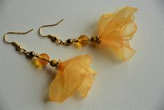 Excited to share the latest addition to my #etsy shop: Golden flower Earrings with gold beads 7cm drop http://etsy.me/2n5mwZV #jewellery #earrings #yellow #floral #gold #women #earlobe #autumncolorearring #dangleearrings