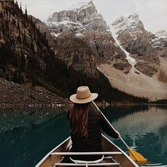 Rowing in a lake and admiring the scenery is a way people might find themselves becoming closer to nature in todays society. Not only is once enjoying the scene but the are becoming one with the water as the push themselves.